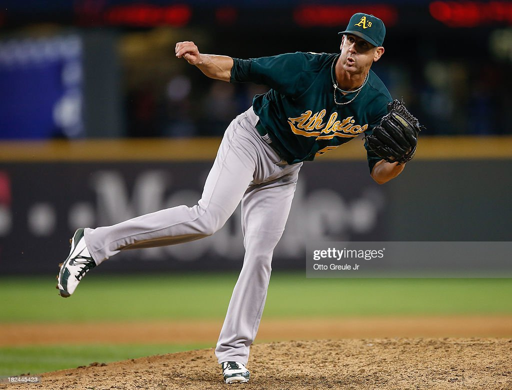 Closing pitcher <a gi-track='captionPersonalityLinkClicked' href=/galleries/search?phrase=Grant+Balfour&family=editorial&specificpeople=833980 ng-click='$event.stopPropagation()'>Grant Balfour</a> #50 of the Oakland Athletics pitches against the Seattle Mariners at Safeco Field on September 29, 2013 in Seattle, Washington. The Athletics defeated the Mariners 9-0.