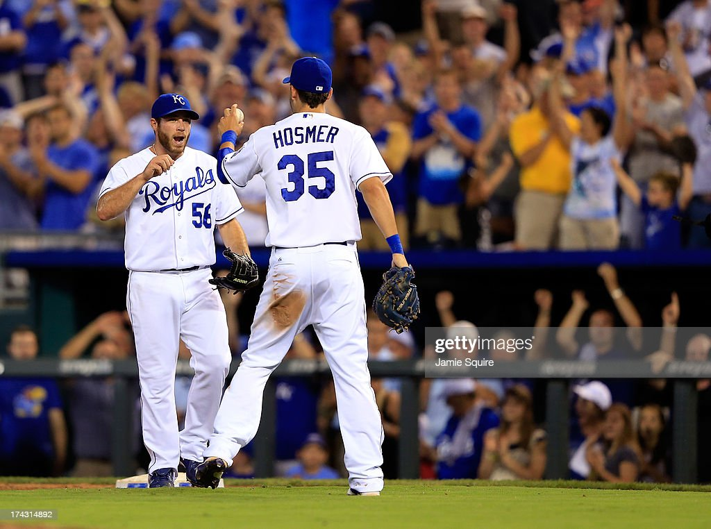 Closing pitcher Greg Holland #56 of the Kansas City Royals celebrates with Eric Hosmer #35 after the Royals defeated the Baltimore Orioles 3-2 to win the game at Kauffman Stadium on July 23, 2013 in Kansas City, Missouri.