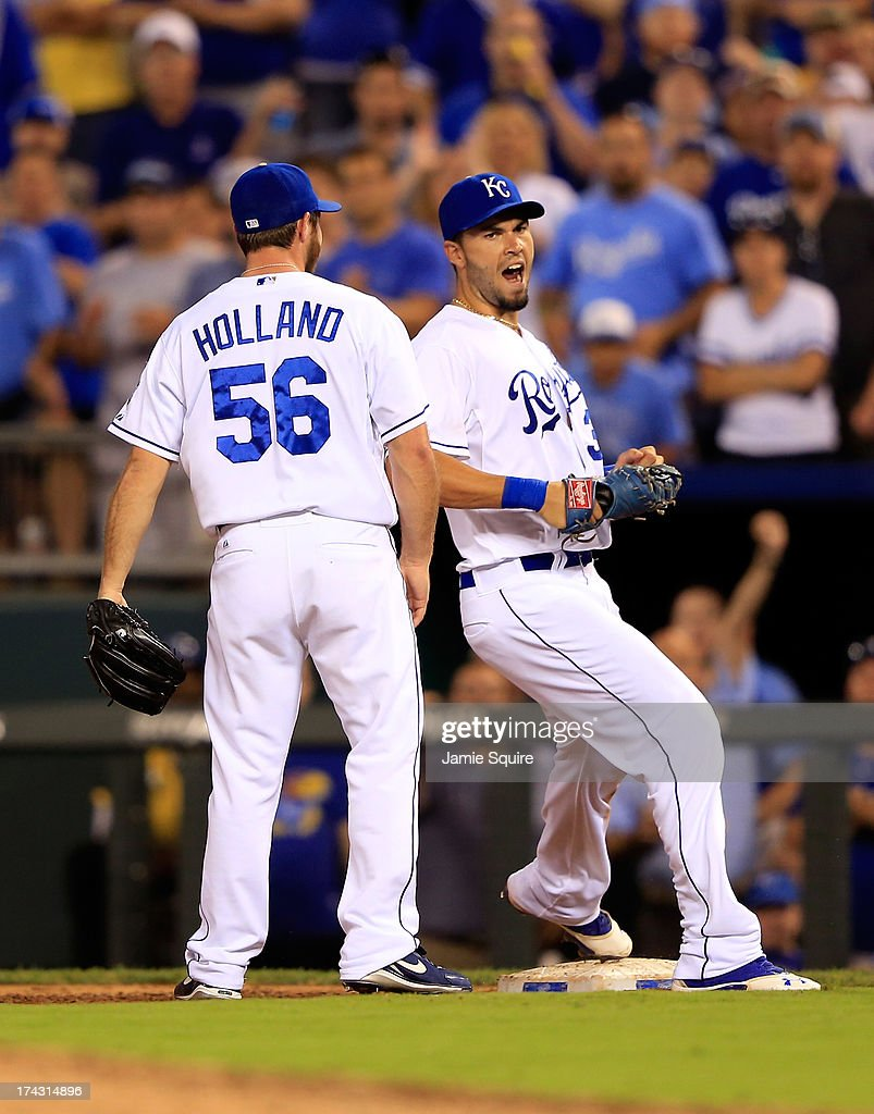 Closing pitcher Greg Holland #56 of the Kansas City Royals celebrates with <a gi-track='captionPersonalityLinkClicked' href=/galleries/search?phrase=Eric+Hosmer&family=editorial&specificpeople=7091345 ng-click='$event.stopPropagation()'>Eric Hosmer</a> #35 after the Royals defeated the Baltimore Orioles 3-2 to win the game at Kauffman Stadium on July 23, 2013 in Kansas City, Missouri.