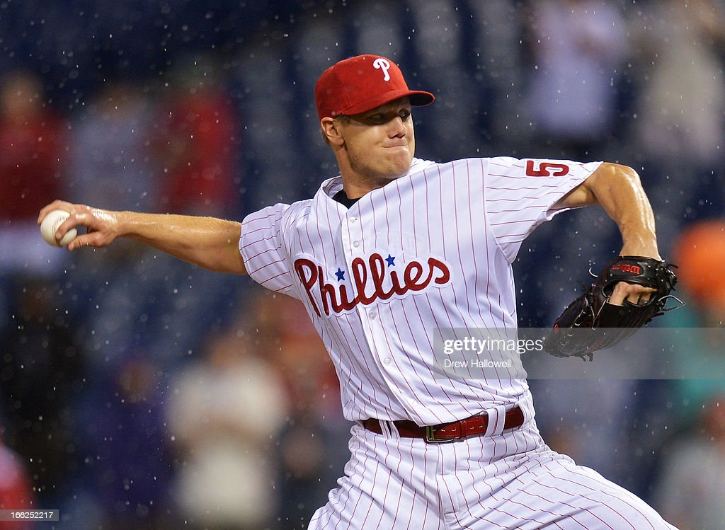 Closing pitcher <a gi-track='captionPersonalityLinkClicked' href=/galleries/search?phrase=Jonathan+Papelbon&family=editorial&specificpeople=453535 ng-click='$event.stopPropagation()'>Jonathan Papelbon</a> #58 of the Philadelphia Phillies delivers the final pitch of the game against the New York Mets at Citizens Bank Park on April 10, 2013 in Philadelphia, Pennsylvania. The Phillies won 7-3.
