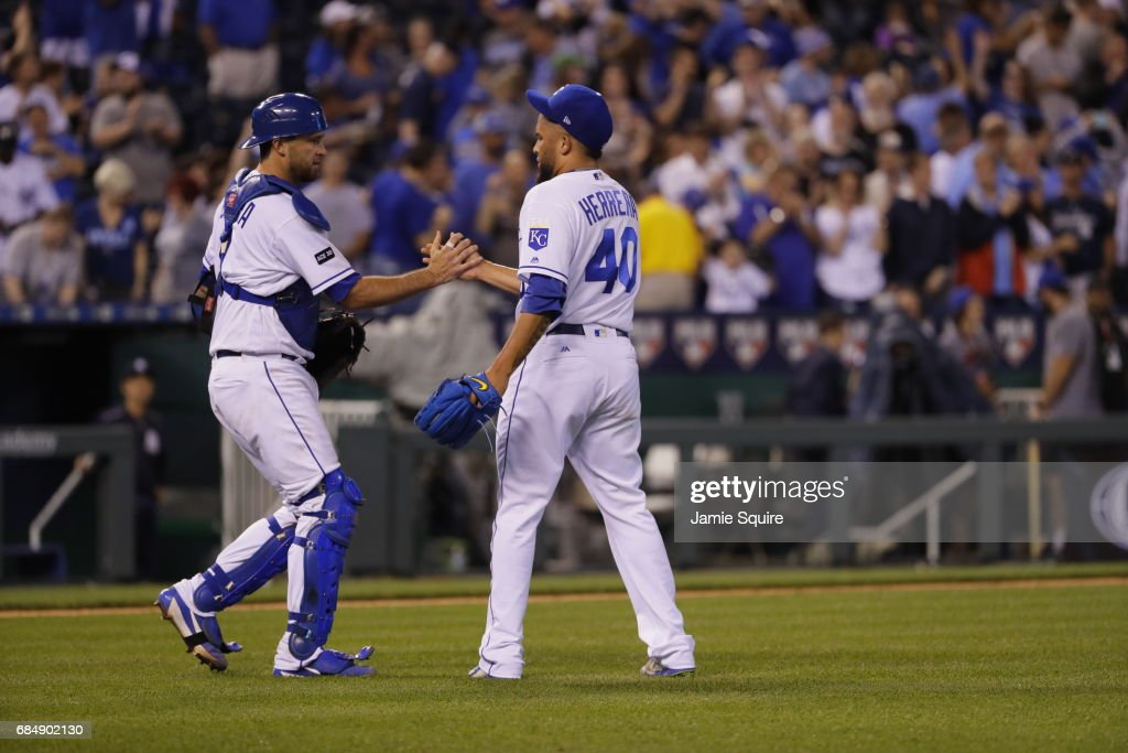 Closing pitcher Kelvin Herrera #40 of the Kansas City Royals is congratulated by catcher Drew Butera #9 after the Royals defeated the New York Yankees to win the game 5-1 at Kauffman Stadium on May 18, 2017 in Kansas City, Missouri.