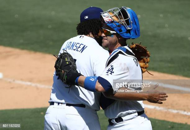 Closing pitcher Kenley Jansen and catcher Yasmani Grandal of the Los Angeles Dodgers celebrate after s 64 win against the San Diego Padres at Dodger...