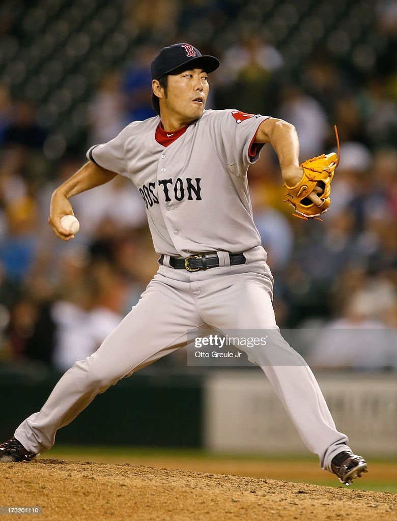 Closing pitcher <a gi-track='captionPersonalityLinkClicked' href=/galleries/search?phrase=Koji+Uehara&family=editorial&specificpeople=801278 ng-click='$event.stopPropagation()'>Koji Uehara</a> #19 of the Boston Red Sox pitches against the Seattle Mariners at Safeco Field on July 9, 2013 in Seattle, Washington. The Red Sox defeated the Mariners 11-8.