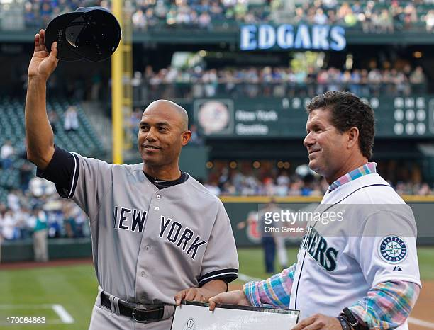 Closing pitcher Mariano Rivera of the New York Yankees acknowledges the crowd after receiving a gift from former Mariners' great Edgar Martinez on...