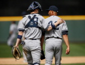 Closing pitcher Mariano Rivera of the New York Yankees is congratulated by catcher Chris Stewart after defeating the Seattle Mariners 31 at Safeco...