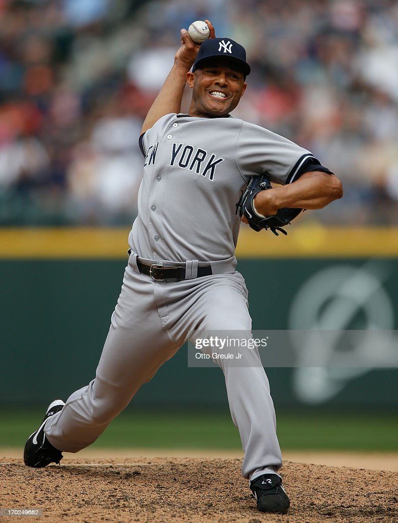 Closing pitcher <a gi-track='captionPersonalityLinkClicked' href=/galleries/search?phrase=Mariano+Rivera&family=editorial&specificpeople=201607 ng-click='$event.stopPropagation()'>Mariano Rivera</a> #42 of the New York Yankees pitches against the Seattle Mariners at Safeco Field on June 9, 2013 in Seattle, Washington. The Yankees defeated the Mariners 2-1.