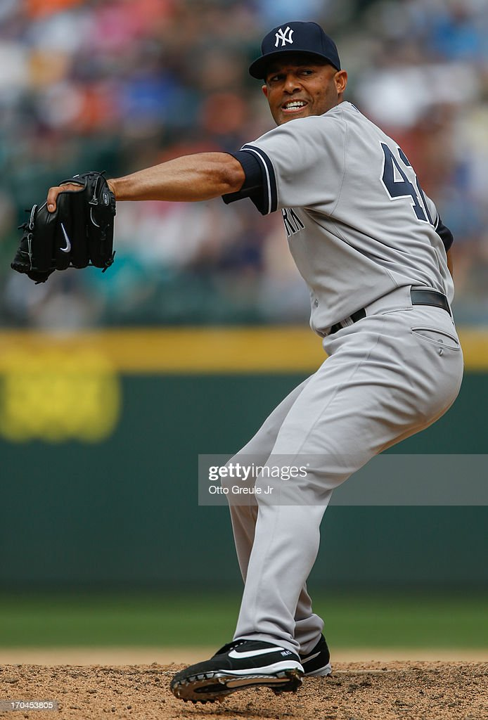 Closing pitcher <a gi-track='captionPersonalityLinkClicked' href=/galleries/search?phrase=Mariano+Rivera&family=editorial&specificpeople=201607 ng-click='$event.stopPropagation()'>Mariano Rivera</a> #42 of the New York Yankees pitches against the Seattle Mariners at Safeco Field on June 9, 2013 in Seattle, Washington.