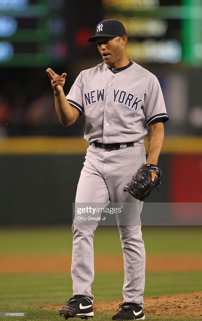 Closing pitcher <a gi-track='captionPersonalityLinkClicked' href=/galleries/search?phrase=Mariano+Rivera&family=editorial&specificpeople=201607 ng-click='$event.stopPropagation()'>Mariano Rivera</a> #42 of the New York Yankees reacts after defeating the Seattle Mariners 3-2 at Safeco Field on September 13, 2011 in Seattle, Washington. Rivera was credited with the save, the 41st of the season and 600th of his career.