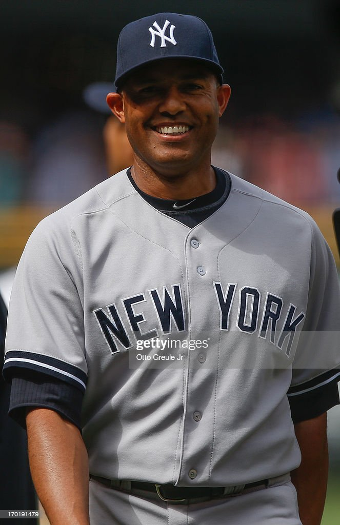 Closing pitcher Mariano Rivera #42 of the New York Yankees smiles as he walks off the field after defeating the Seattle Mariners 3-1 at Safeco Field on June 8, 2013 in Seattle, Washington.