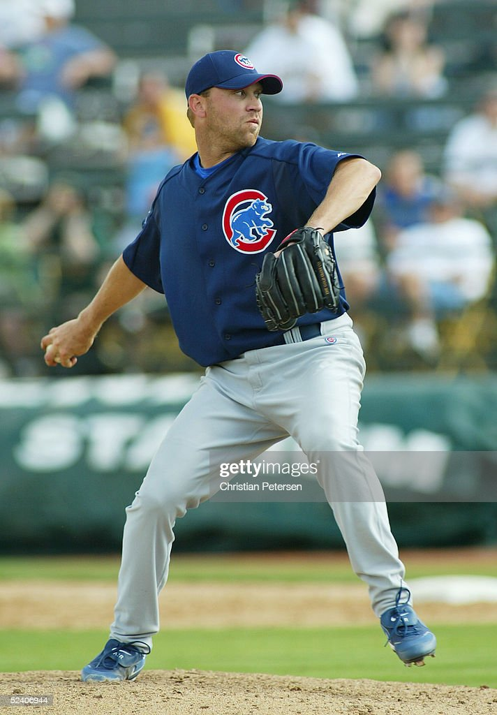 Closing pitcher Michael Wuertz #43 of the Chicago Cubs pitches during the MLB spring training game against the Oakland Athletics at Phoenix Municipal Stadium on March 3, 2005 in Phoenix, Arizona. The Cubs defeated the A's 2-1.