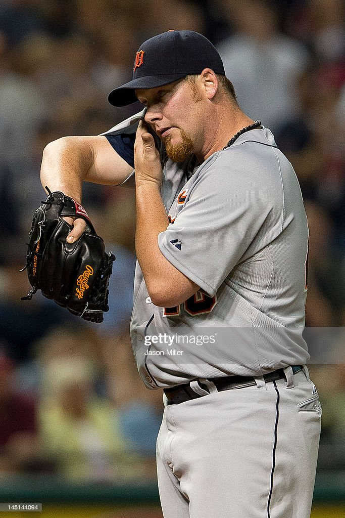 Closing pitcher Phil Coke #40 of the Detroit Tigers wipes his face during the eighth inning against the Cleveland Indians at Progressive Field on May 23, 2012 in Cleveland, Ohio.