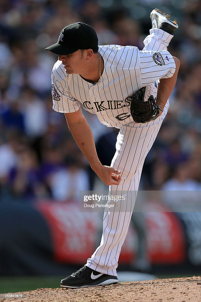 Closing pitcher <a gi-track='captionPersonalityLinkClicked' href=/galleries/search?phrase=Rafael+Betancourt&family=editorial&specificpeople=224728 ng-click='$event.stopPropagation()'>Rafael Betancourt</a> #63 of the Colorado Rockies works against the San Diego Padres during Opening Day at Coors Field on April 5, 2013 in Denver, Colorado. Betancourt earned a save as the Rockies defeated the Padres 5-2.