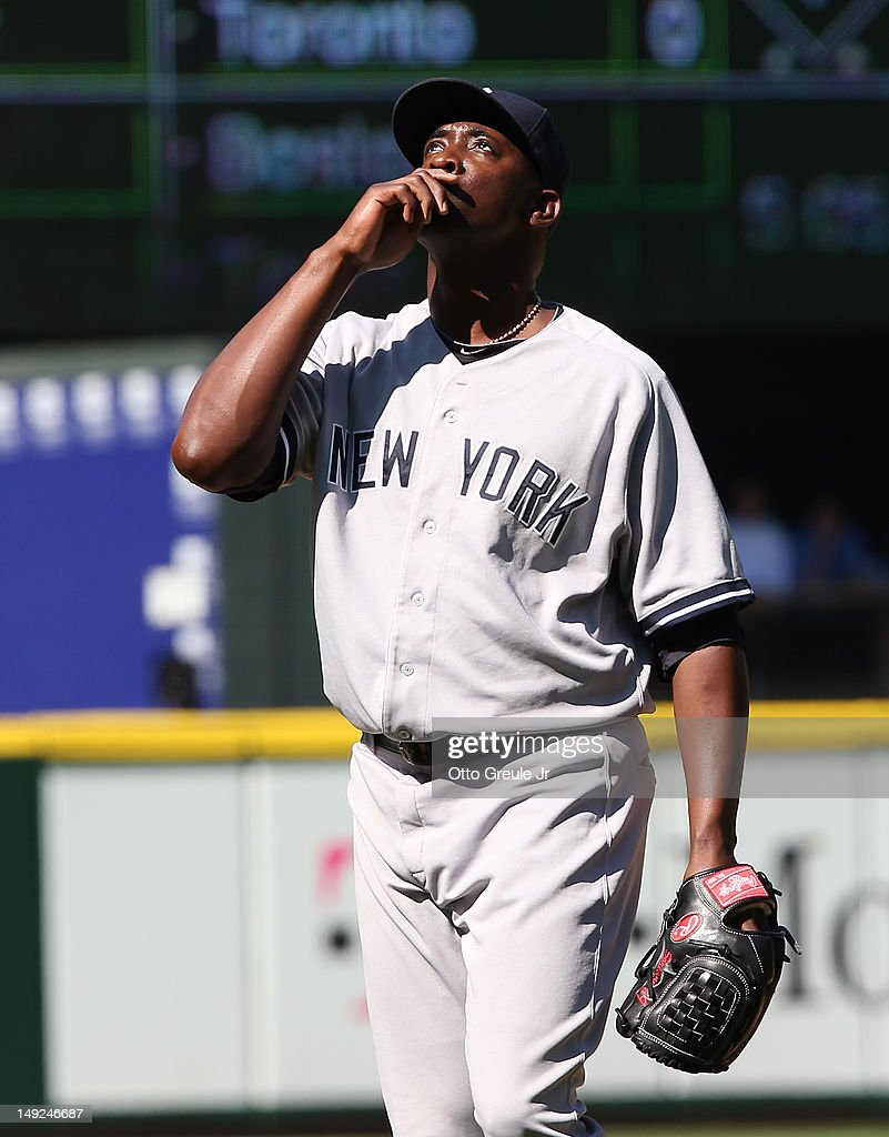 Closing pitcher Rafael Soriano #29 of the New York Yankees looks skyward after defeating the Seattle Mariners 5-2 at Safeco Field on July 25, 2012 in Seattle, Washington.
