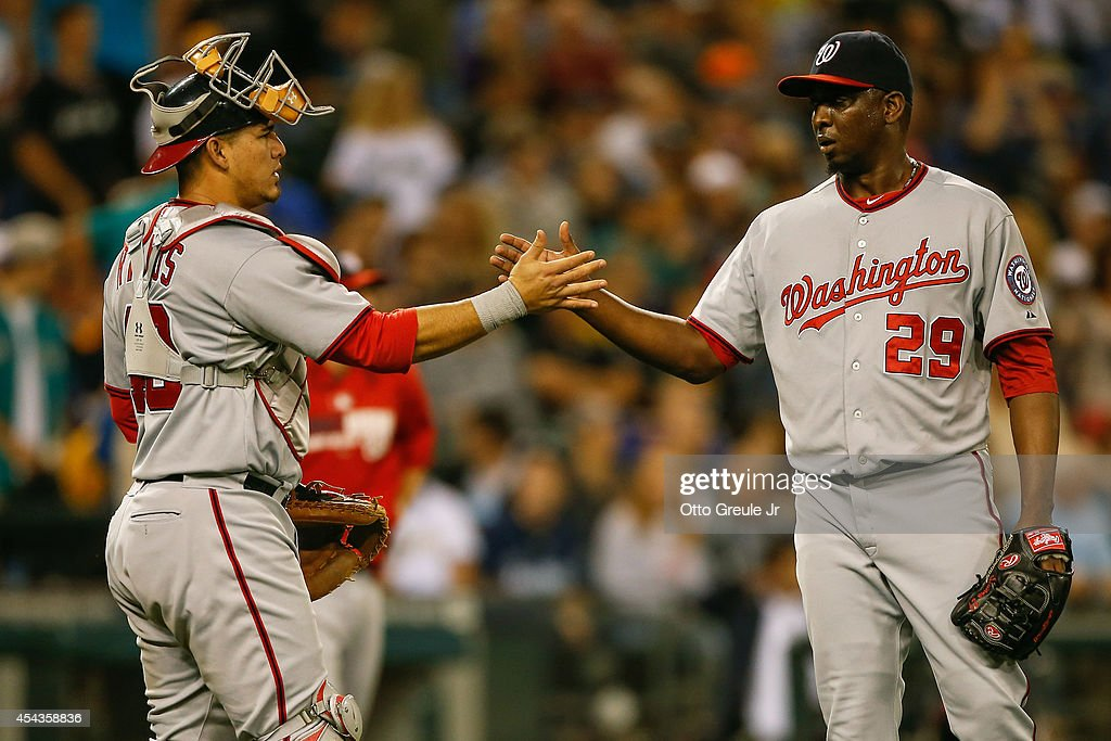 Closing pitcher <a gi-track='captionPersonalityLinkClicked' href=/galleries/search?phrase=Rafael+Soriano&family=editorial&specificpeople=587892 ng-click='$event.stopPropagation()'>Rafael Soriano</a> #29 of the Washington Nationals is congratulated by catcher <a gi-track='captionPersonalityLinkClicked' href=/galleries/search?phrase=Wilson+Ramos&family=editorial&specificpeople=4866956 ng-click='$event.stopPropagation()'>Wilson Ramos</a> #40 after defeating the Seattle Mariners 8-3 at Safeco Field on August 29, 2014 in Seattle, Washington.