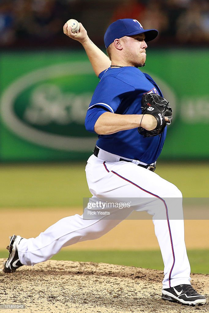 Closing pitcher Robbie Ross #46 of the Texas Rangers throws in the ninth inning against the Cincinnati Reds at Rangers Ballpark in Arlington on June 28, 2013 in Arlington, Texas.