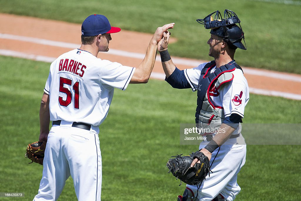 Closing pitcher Scott Barnes #51 celebrates with catcher <a gi-track='captionPersonalityLinkClicked' href=/galleries/search?phrase=Yan+Gomes&family=editorial&specificpeople=9004037 ng-click='$event.stopPropagation()'>Yan Gomes</a> #10 of the Cleveland Indians at Progressive Field on May 9, 2013 in Cleveland, Ohio. The Indians defeated the Athletics 9-2.