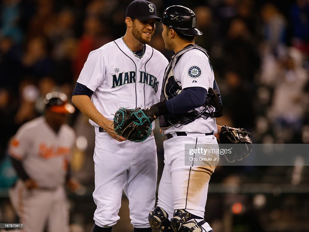 Closing pitcher Tom Wilhelmsen #54 of the Seattle Mariners celebrates with catcher Jesus Montero #63 after defeating the Baltimore Orioles 8-3 at Safeco Field on May 1, 2013 in Seattle, Washington.
