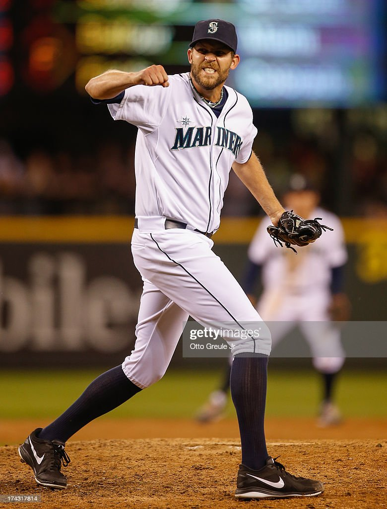 Closing pitcher Tom Wilhelmsen #54 of the Seattle Mariners celebrates after defeating the Cleveland Indians 4-3 at Safeco Field on July 23, 2013 in Seattle, Washington.
