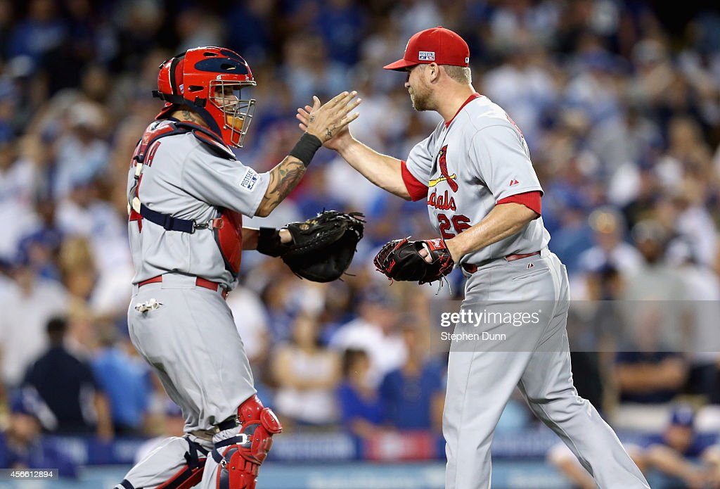 Closing pitcher <a gi-track='captionPersonalityLinkClicked' href=/galleries/search?phrase=Trevor+Rosenthal&family=editorial&specificpeople=9003011 ng-click='$event.stopPropagation()'>Trevor Rosenthal</a> #26 of the St. Louis Cardinals celebrates with teammate catcher <a gi-track='captionPersonalityLinkClicked' href=/galleries/search?phrase=Yadier+Molina&family=editorial&specificpeople=172002 ng-click='$event.stopPropagation()'>Yadier Molina</a> #4 after their 10-9 win over the Los Angeles Dodgers in Game One of the National League Division Series at Dodger Stadium on October 3, 2014 in Los Angeles, California.