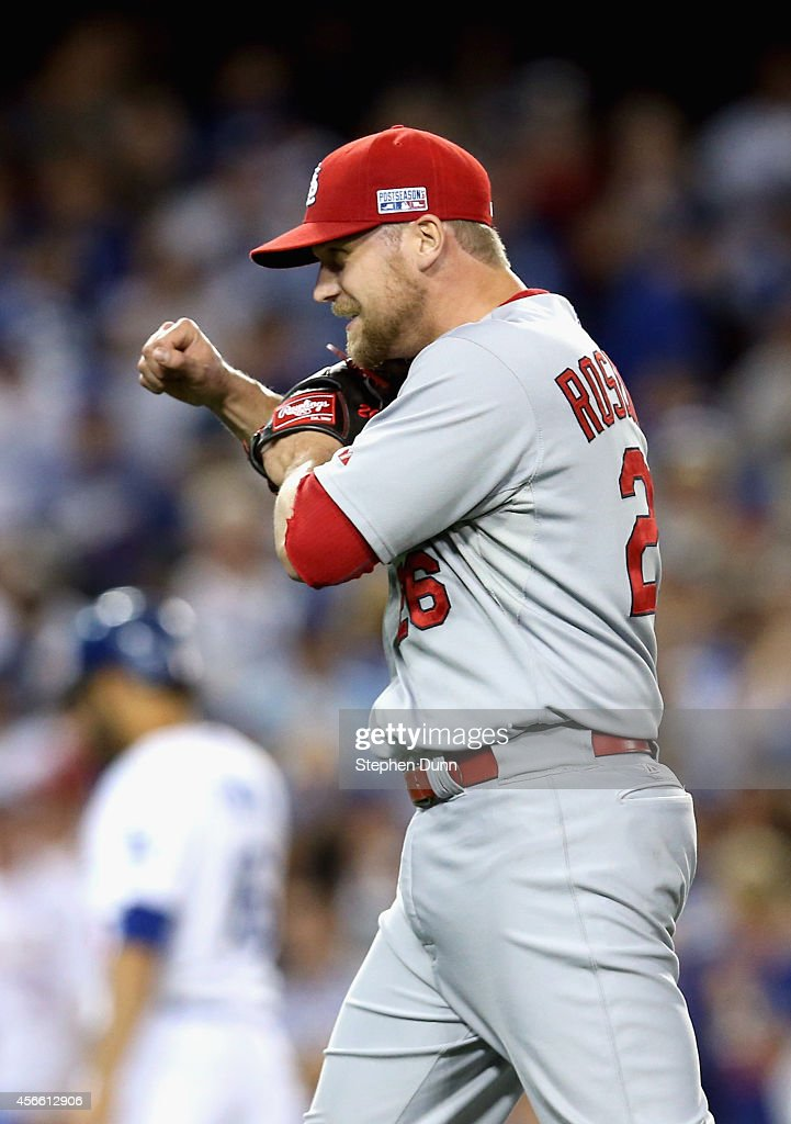 Closing pitcher <a gi-track='captionPersonalityLinkClicked' href=/galleries/search?phrase=Trevor+Rosenthal&family=editorial&specificpeople=9003011 ng-click='$event.stopPropagation()'>Trevor Rosenthal</a> #26 of the St. Louis Cardinals celebrates after the last out of Game One of the National League Division Series against the Los Angeles Dodgers at Dodger Stadium on October 3, 2014 in Los Angeles, California. The St. Louis Cardinals won the game 10-9 over the Los Angeles Dodgers.