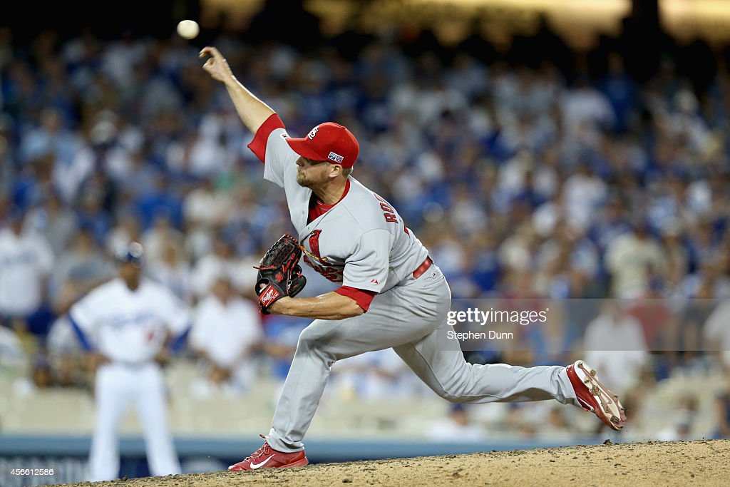 Closing pitcher <a gi-track='captionPersonalityLinkClicked' href=/galleries/search?phrase=Trevor+Rosenthal&family=editorial&specificpeople=9003011 ng-click='$event.stopPropagation()'>Trevor Rosenthal</a> #26 of the St. Louis Cardinals pitches against the Los Angeles Dodgers in the ninth inning of Game One of the National League Division Series at Dodger Stadium on October 3, 2014 in Los Angeles, California.