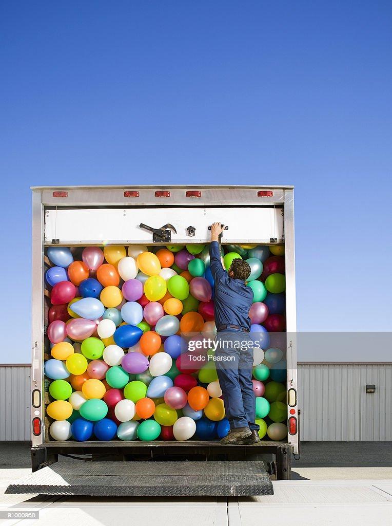 Closing the Truck Door : Stock Photo