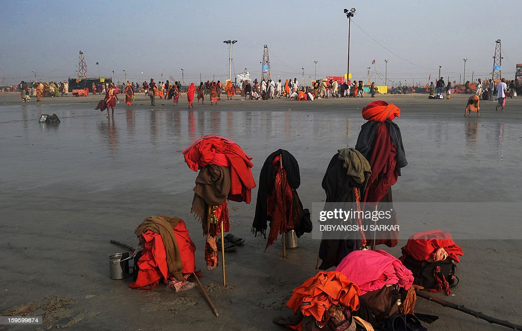 Clothers of hindu Sadhus - Holy man - hang on their tridents whilst they take a 'holy dip' at the Gangasagar island, some 160 kms south of Kolkata on January 15, 2013. Sadhus and Hindu piligrims from all over the country come for the annual Hindu holy festival Gangasagar Mela, with more than four hundred thousand Hindu pilgrims gathering at the Gangasagar to take a 'holy dip' in the ocean at the confluence of the River Ganges and the Bay of Bengal on the occasion of Makar Sankranti, a holy day of the Hindu calendar considered to be of great religious significance in Hindu mythology. AFP PHOTO/Dibyangshu SARKAR