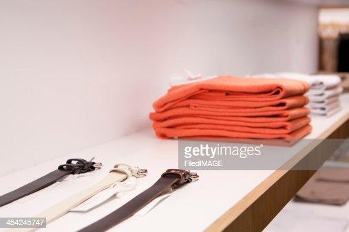 Clothes and Belts On a Rack : Stock Photo