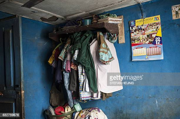 Clothes and items belonging to the Amos's family are seen in a bedroom accommodation which the family shares on January 6 2017 in Lagos Nearly two...