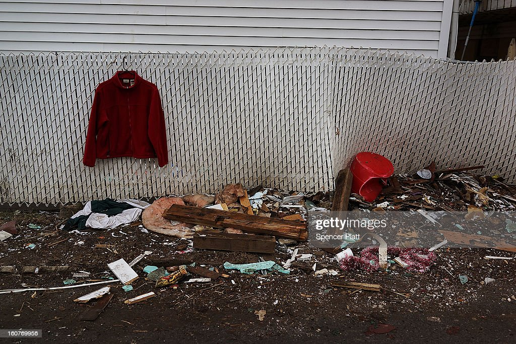 Clothes and other debris are viewed outside of a destroyed home in Oakwood Beach in Staten Island on February 5, 2013 in New York City. In a program proposed by New York Governor Andrew Cuomo, New York state could spend up to $400 million to buy out home owners whose properties were destroyed by Superstorm Sandy. The $50.5 billion disaster relief package, which was passed by Congress last month, would be used to fund the program. If the program is adopted, homeowners would be relocated and their land would be left as a natural barrier to help absorb future floods waters.