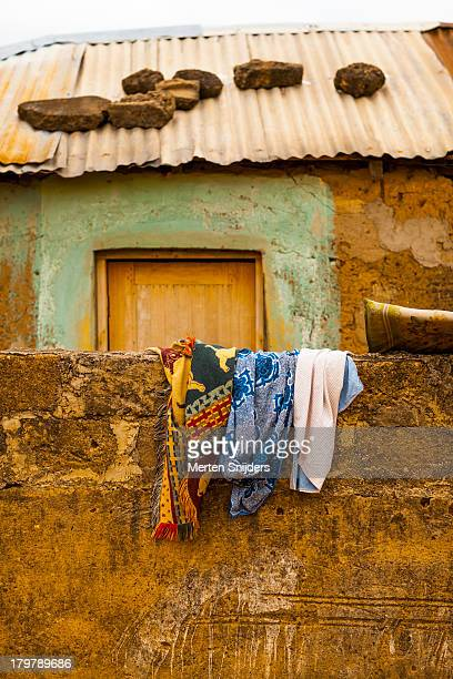 Clothes and rocks on corrugated roof