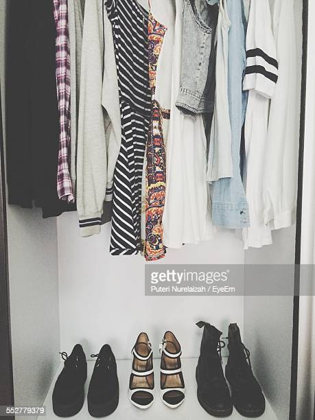 Clothes And Shoes Arranged In Closet