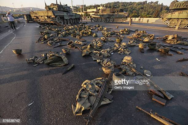 Clothes and weapons beloging to soldiers involved in the coup attempt that have now surrendered lie on the ground abandoned onBosphorus bridge on...