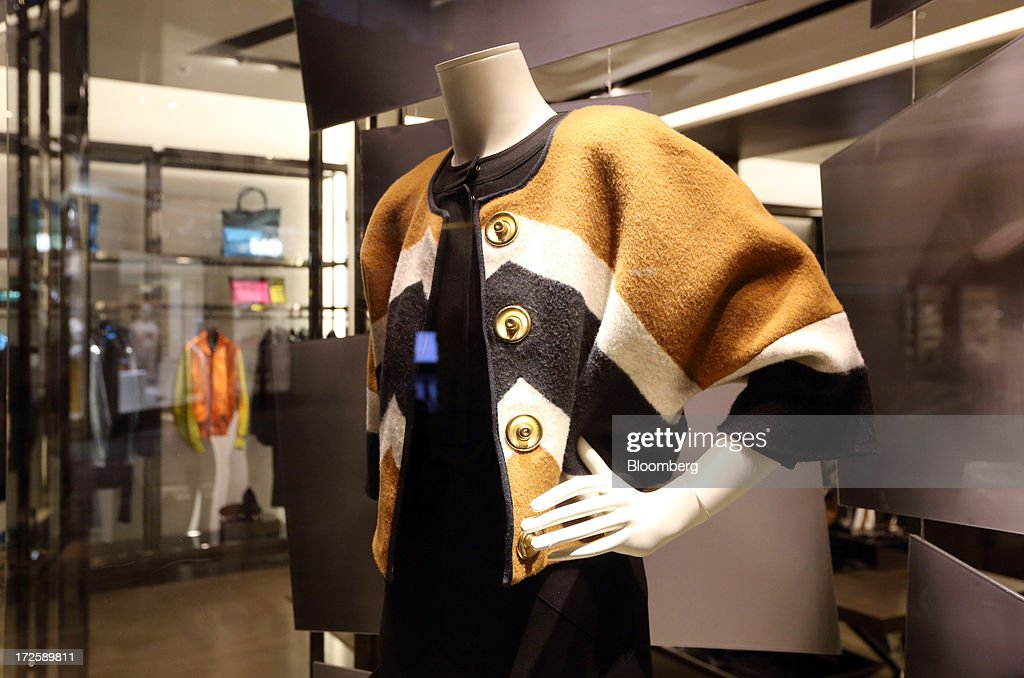Clothes are displayed on a mannequin at a Burberry store, operated by Burberry Group Plc, in Shanghai, China, on Tuesday, July 2, 2013. Banks including Goldman Sachs Group Inc. have pared their growth projections for China this year to 7.4 percent, below the government's 7.5 percent goal disclosed at the March conference at which Li Keqiang became premier. Photographer: Tomohiro Ohsumi/Bloomberg via Getty Images