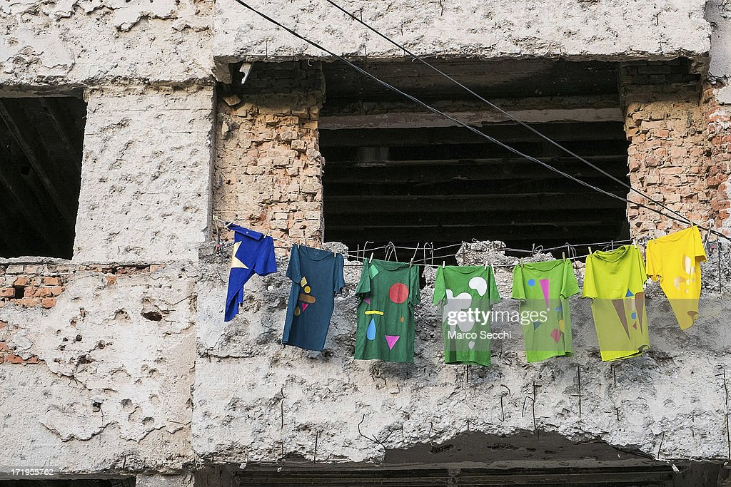Clothes are hung in front of a concrete wall damaged by bulletts from the 1993 war as the city of Mostar remembers the 1993 conflict on June 28 2013...