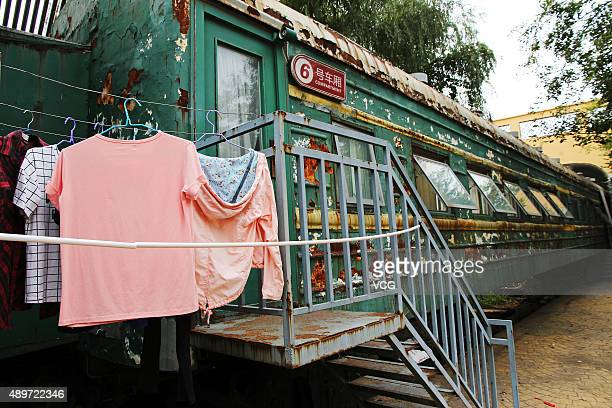 Clothes are hung out of a dormitory converted from a retired train at Sihe Art School on September 23 2015 in September 23 2015 in Zhengzhou Henan...