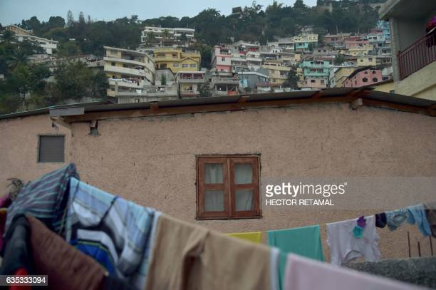 Clothes are seen hanging near a house in Jalousie neighborhood in the commune of Petion Ville in the Haitian capital PortauPrince on February 14 2017...