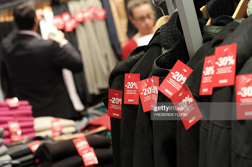 Clothes bear labels in preparation of the sales, on January 08, 2013 in a shop in Strasbourg, eastern France, on the eve of the start of the winter sales. AFP PHOTO/FREDERICK FLORIN