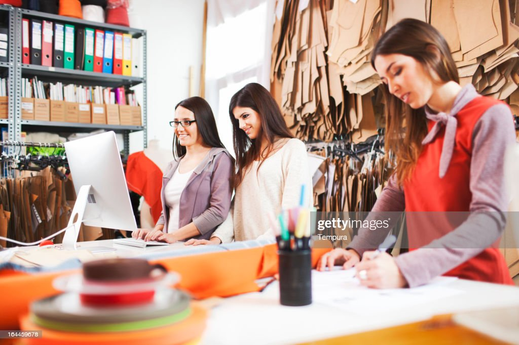 Clothes designer in her small business studio. : Stock Photo