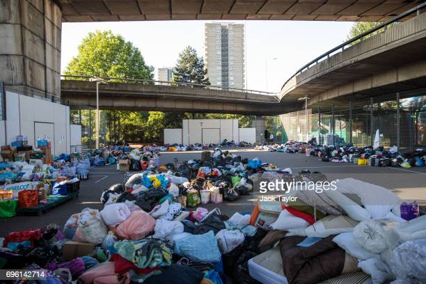 Clothes donations lie piled up in the Westway Sports Centre near to the site of the Grenfell Tower fire on June 15 2017 in London England At least...