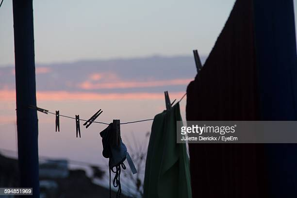 Clothes Drying On Rope At Sunset