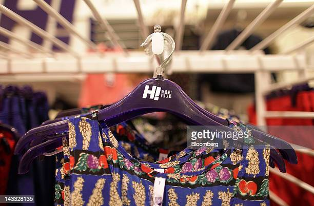 Clothes from the Henry Holland range hang on display in a Debenhams Plc store at Westfield London shopping mall operated by Westfield Group in London...