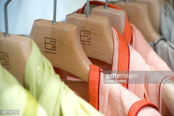 Clothes hang in Shangxia first store on September 15 2010 in Shanghai China Shangxia is a Chinese luxury brand launched by Hermes Shangxia is owned...
