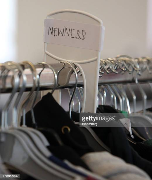Clothes hang on a rail at the headquarters of Asos Plc in London UK on Wednesday July 17 2013 Asos Plc the UK's largest onlineonly fashion retailer...