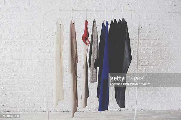 Clothes Hanging Against White Wall