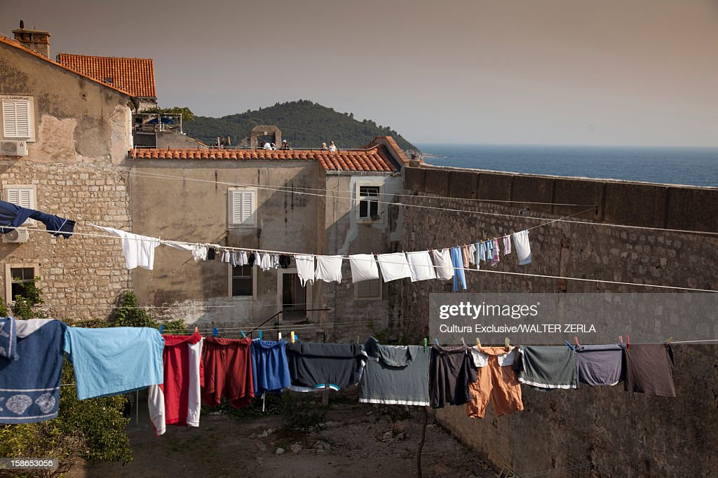 Clothes hanging from lines on rooftops : Stock Photo