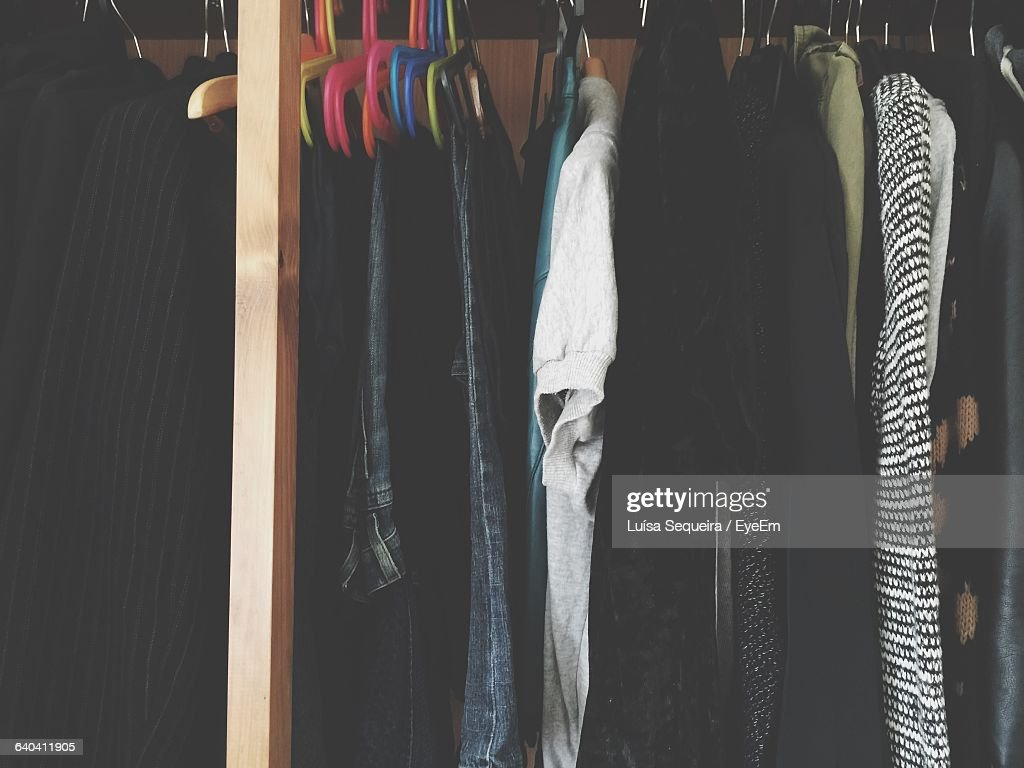 clothes hanging on closet at home stock photo getty images