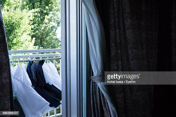 Clothes Hanging On Railing At Balcony
