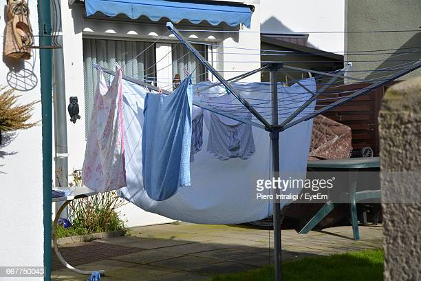 Clothes Hanging On Rotary Washing Line In Yard