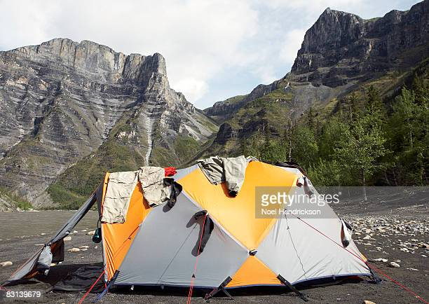 clothes hanging on tent in valley
